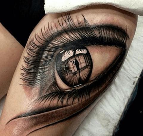 tattoo en el brazo, ojo realista